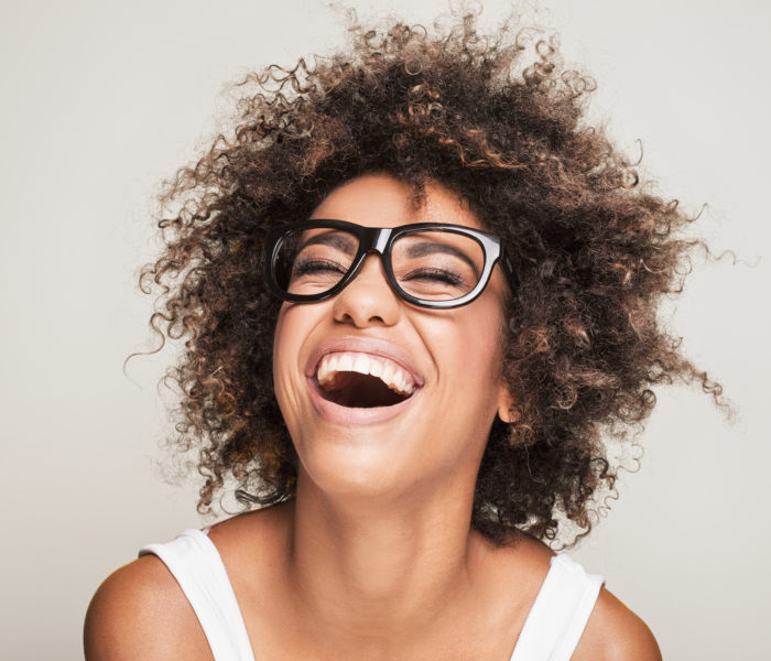 Young women with glasses smiling
